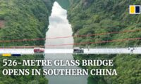 New glass bridge thrills visitors with walk over 526-metre (1,725ft) wide span in southern China